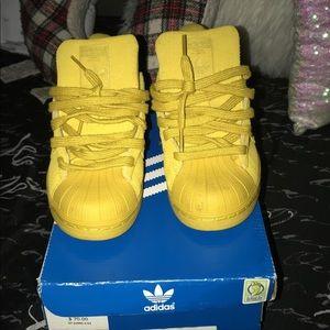 Yellow shell-toe adidas